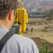Land surveyor behind theodolite — Stock Photo #34360369