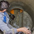 Stock Photo: Sewer maintenance, cleaning sewers 2
