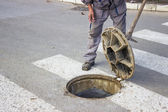 Utilities worker moves the manhole cover 2 — Stock Photo