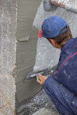 Building worker spreading mortar on concrete wall 2 — Stock Photo