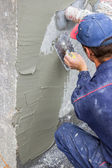 Building worker spreading mortar on concrete wall 3 — Stock Photo