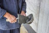 Trowel spreading mortar on concrete wall — Stockfoto