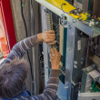 Stock Photo: Installing Traveling Cable, elevator parts installation