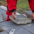 Stock Photo: Measure and marking pavement stone before cutting 2