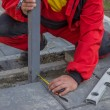 Measure and marking pavement stone before cutting 3 — Stock Photo