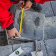 Stock Photo: Measure and marking pavement stone before cutting
