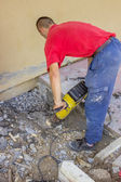Builder worker with electric jackhammer 3 — Stock Photo