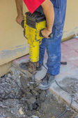 Builder worker with electric jackhammer 2 — Stock Photo