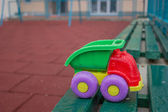 Children plastic toy truck in park on a bench 2 — Stock Photo