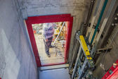 In elevator shaft, installing elevator — Stock Photo