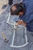 Man welding a chair 3 — Stock Photo