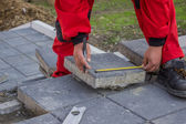 Measure and marking pavement stone before cutting 2 — Stock Photo