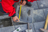 Measure and marking pavement stone before cutting — Stock Photo