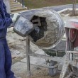 Builder worker putting water in a cement mixer 2 — Stock Photo