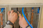 Electrician connecting wires in the electrical cabinet 2 — Stock Photo