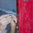 Worker hands adjusting mechanism of lift door — Stock Photo