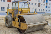 Yellow road roller in the new residential area 2 — Stock Photo