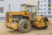 Yellow road roller in the new residential area 3 — Stock Photo