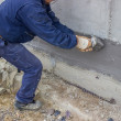 Stock Photo: Construction worker with brush applied hydro insulation 2