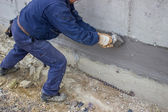 Construction worker with brush applied hydro insulation 2 — Stock Photo
