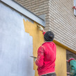 Builder workers plastering exterior wall 2 — 图库照片