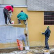 Stock Photo: Builder workers plastering facade