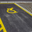 Handicap symbol painted on asphalt at parking space — Stock Photo #37092655