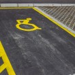 Stock Photo: Handicap symbol painted on asphalt at parking space