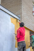 Builder workers plastering exterior wall 2 — Stock Photo
