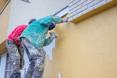 Builder workers plastering exterior wall 3 — Stock Photo