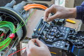 Fibre optic technician splicing fibers 2 — Stock Photo