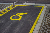 Handicap symbol painted on asphalt at parking space 2 — Stok fotoğraf