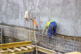 Builder worker cleaning after usingusing a jackhammer — Stock Photo