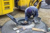 Manhole cover replacement, street reconstruction and improvement — Stock Photo