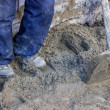 Stock Photo: Builder worker tamping sand bedding with feet 2