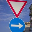 Traffic sign for give way priority yield road and blue direction — Stock Photo #39298375