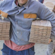 Workers carries packages of beech wood profiles — Stock Photo