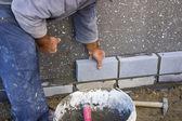 Builder laying bricks, constructing a wall — Stock Photo