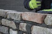 Brick mason laying old brick — Stock Photo