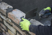 Brick mason using trowel to spread a mortar 2 — Foto Stock