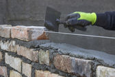 Build a brick wall, bricklaying spreading a bed joint 2 — Stock Photo