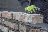 Installing brick, build a brick wall 2 — Stock Photo