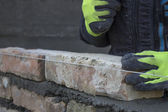 Installing brick, build a brick wall — Stock Photo