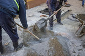 Worker is mixing the cement by hand — Stock Photo