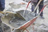 Workers mixing the cement by hand in wheelbarrow 3 — Stock Photo