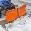 Tractor snowplow is cleaning the pedestrian crossing and sprinkl — Stock Photo #39670107