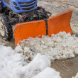 Tractor snowplow is cleaning the pedestrian crossing and sprinkl — Stock Photo #39670115