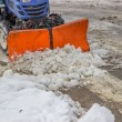Tractor snowplow is cleaning the pedestrian crossing and sprinkl — Stock Photo #39670129
