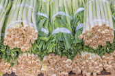 Closeup of a fresh bunch of leek at the farmers market, Allium a — Stock Photo