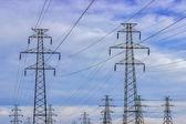 High voltage power line poles — Stock Photo